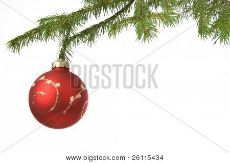 Christmas decoration ball and fir branch over white background