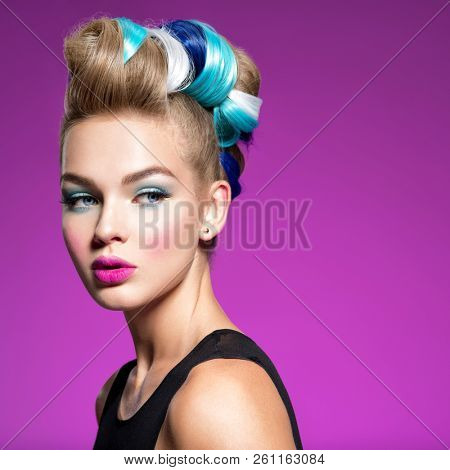 Beauty Fashion Model Girl with  ?olorful Dyed Hair. Girl with blue makeup and hairstyle. Blue makeup. Studio.