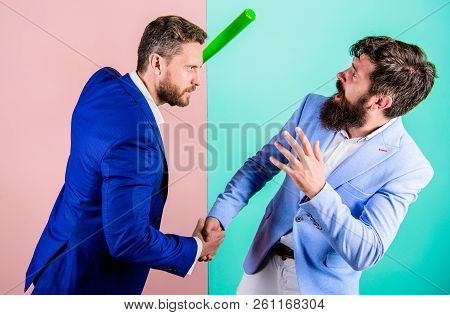 Businessman raise bat while shaking hands. Hidden threat concept. Business partners competitors office colleagues shaking hands. Tricky first impression. Dangerous ties. Threat with violence poster