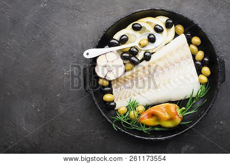 A Dish Of Healthy Cuisine With Seafood: Cod Is A White Sea Fish With Lemon Slices, Olives, Sea Salt