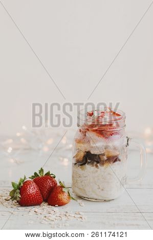 Healthy Overnight Oats With Fresh Strawberry Served In A Glass Jar On Wooden Table. Breakfast Recipe