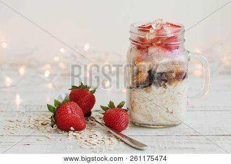 Easy Breakfast Recipe: Overnight Oats With Strawberry, Dried Fruits And Coconut Milk. Healthy Puddin