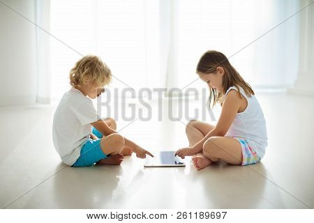 Child With Tablet Computer. Pc For Kids.