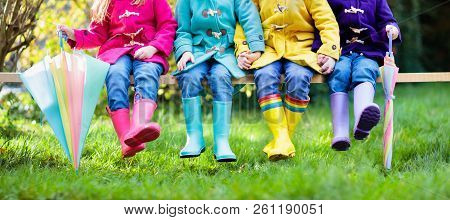 Group Of Kids In Rain Boots. Colorful Footwear For Children. Boys And Girl In Rainbow Wellies And Du