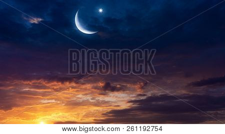 Crescent Moon With Beautiful Sunset Background .  Light From Sky . Religion Background . Beautiful S