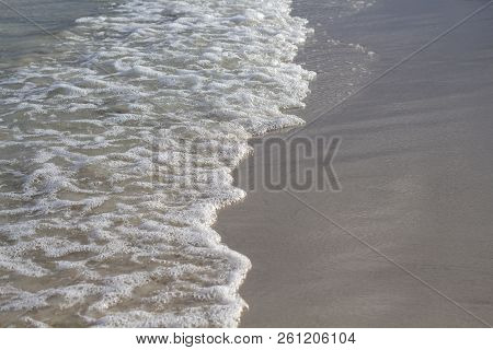 Sea Water Tide On White Sand Beach. Foamy Sea Wave On Smooth Sand. Tropical Seaside Photo. Summer Va