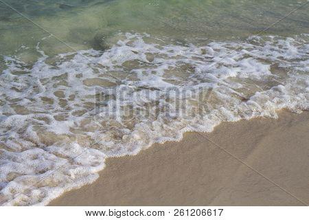 Sea Water Tide On White Sand Beach. Blue Sea Wave On Smooth Sand. Tropical Seaside Photo. Summer Vac