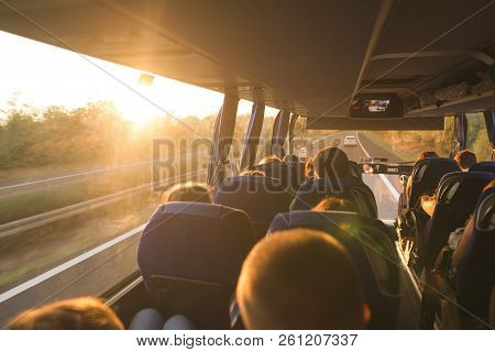 Background. Travel By Bus. Bus Interior. Salon Of The Bus With People Fill The Sun With Light In The