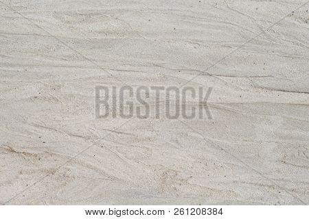 White Sand Beach Texture. Sea Coast Top View Photo. Natural Texture. Smooth Sand Surface With Sea Wa