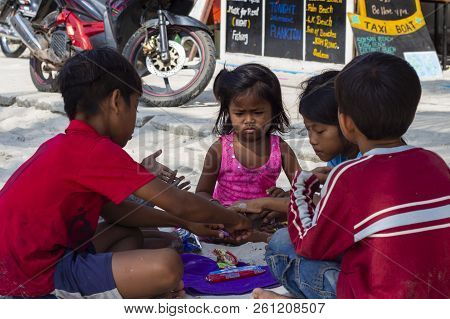 Koh Rong Island, Cambodia - April 7, 2018: Khmer Children On Village Street. Playing Kids With Emoti
