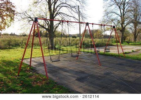 Empty Autumn Swings