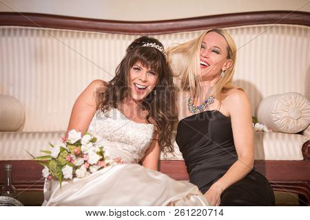 Friend Laughing With A Bride After A Long Wedding Day