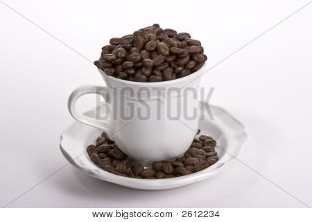 Coffee Cup Full Of Beans