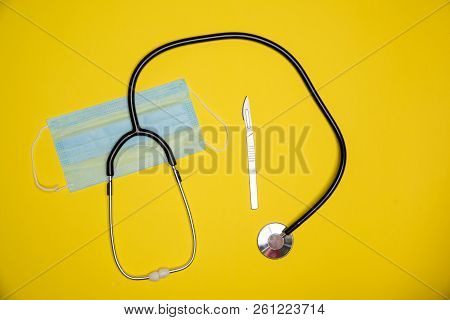 Precission Sharp Knife With Sterile Mouth Face Mask And Stethoscope. Heathcare Diagnosis Equipment