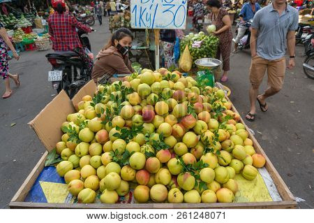Ho Chi Minh City, Vietnam - August 25, 2017: Fruit Seller On Cho Xom Chieu Market In Hcmc In Vietnam