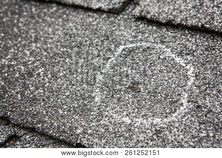 Hail damage on roof after hailstorm