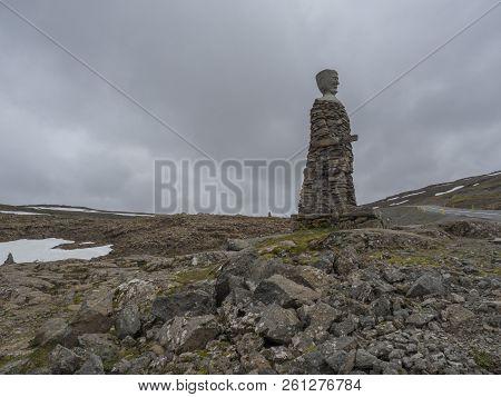 Iceland, West Fjords, Isafjordur, June 25, 2018: Big Kleifabui Statue Made From Natural Stones At Kl