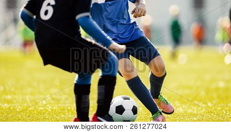 Soccer Players Running In Action. Football Match. Young Soccer Players Running With The Ball. Boys K