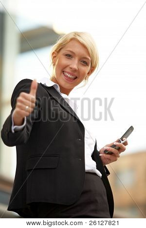 Young Businesswoman Thumbs Up