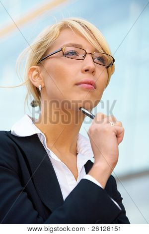 Young Businesswoman Contemplating