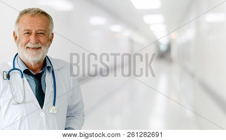 Senior Male Doctor Working At The Hospital.