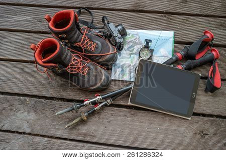 Map, Compass, Camera, Touchpad And Hiking Poles And Boots For Traveling, Paste Space, Gears, Tools