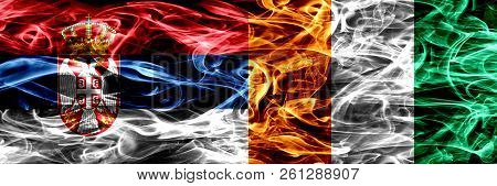 Serbia Vs Ivory Coast Smoke Flags Placed Side By Side. Thick Colored Silky Smoke Flags Of Serbian An