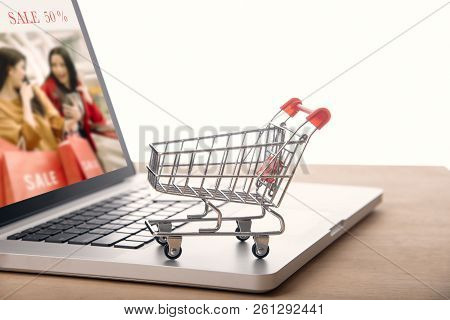 Trolley On Laptop Computer With Web Page Shopping Online. E-commerce Marketing Concept.