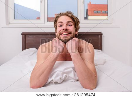 Pleasant relax concept. Let your body feel comfortable. Man unshaven handsome happy smiling torso relaxing bed. Guy sexy macho lay white bedclothes. Man feel full of energy after pleasant night dream poster