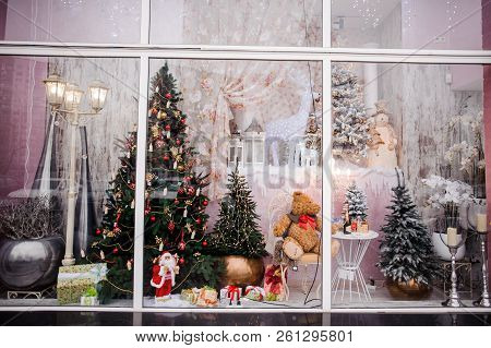 Beautiful Festive Christmas Storefront With Decorated Artificial Christmas Trees And Toys On The Pin