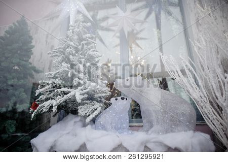 Christmas Storefront With Decorated Artificial Christmas Trees And Polar Bears Toys On Snow And Beau