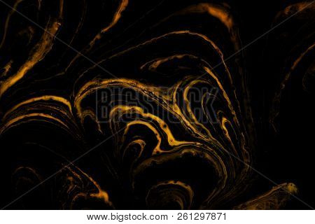 Gold And Black Marble Patterned Texture Background.