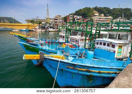 Keelung, Taiwan - September 5, 2018: Blue Wooden Fishing Boats Are Moored In Fishing Harbor Of Keelu