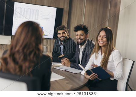 Business Woman On A Job Interview With Three Human Resources Representatives As A Board Members. Foc