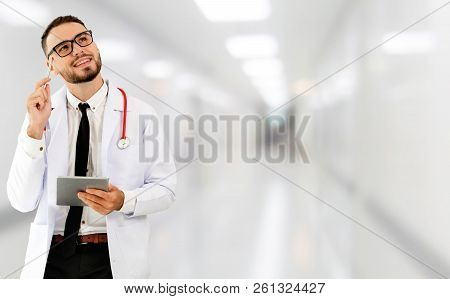 Doctor Using Tablet Computer At The Hospital.