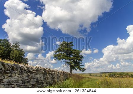 Limestone Wall, Cumulus Clouds, Blue Sky, Tallgrass Prairie National Preserve, Kansas