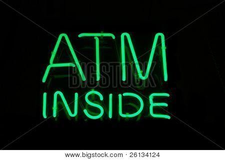 Illuminated ATM Inside neon sign on black