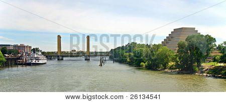 Landmarks of Sacramento, California: Delta King Riverboat, I Street Bridge, Sacramento River and the Ziggurat Pyramid Building.