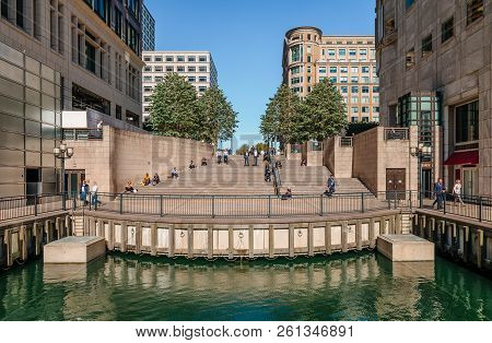 London, UK - September 17, 2018: View of the steps that lead to Cabot Square from the  Middle Dock. Cabot Square is one of the central squares of the Canary Wharf Development in London s Docklands.