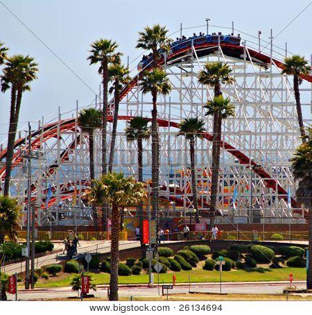 Front of the Santa Cruz Beach Boardwalk amusement park featuring the historic Big Dipper wooden rollercoaster