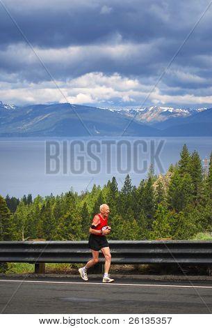 77-year-old man running uphill in a race, Daggett Pass, Lake Tahoe, Nevada