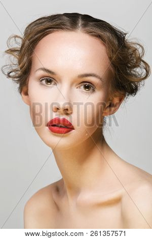 Beautiful Young Fair-haired Woman Close-up Face Portrait. Beauty Model Girl With Bright Eyebrows, Be