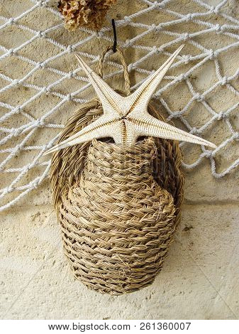 Wicker Jug And Starfish On The Grid. Marine Design