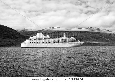 Cruising For Pleasure. Cruise Ship In Sea On Mountain Landscape In Sejdisfjordur, Iceland. Ocean Lin