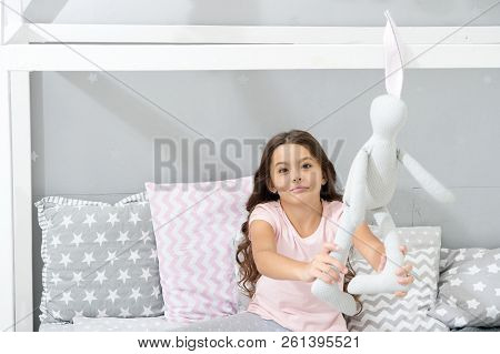 Play Soft Toy Before Go Sleep. Girl Long Curly Hair Enjoy Evening Time With Favorite Toy. Kid Sit Be