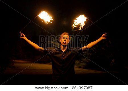 Fire Show. The Fakir Juggles Poi. Night Performance.
