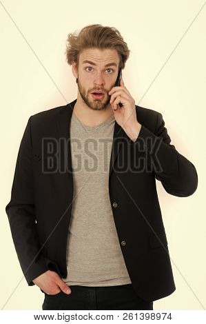 Guy Or Young Bearded Man With Formal Jacket Using Mobile Phone Device, Surprised Guy Isolated On Whi