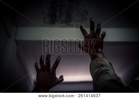Zombie Stretching Bloody Hands In Dark Room