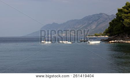 Still Life With Motor Boats For Rent At Sea Near Brela In Croatia. In The Background Is The Biokovo