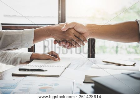 Business Handshake After Discussing Good Deal Of Trading To Sign Agreement And Become A Business Par